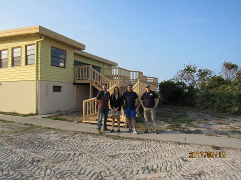Chris, Alex, Robert, and Glenn in from of the Beach House site